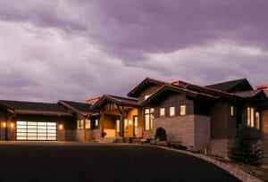 The sun sets on a custom home in park city, utah | Highland Custom Homes