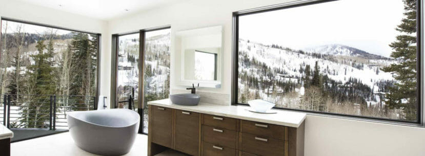 This bathroom has views of the snowy wasatch mountains of Utah
